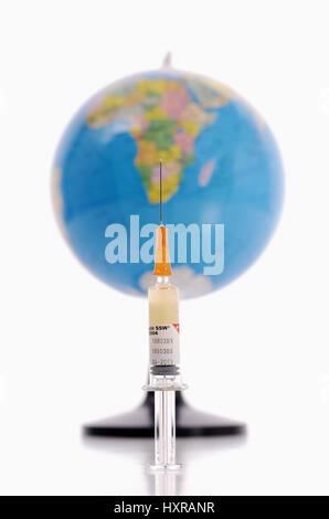 Syringe and globe, symbolic photo vaccination against the pork influenza, pandemic, Spritze und Erdkugel, Symbolfoto - Stock Photo