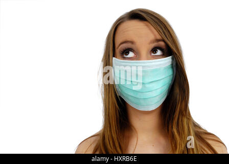 Woman with mask, pork influenza, Frau mit Mundschutz, Schweinegrippe - Stock Photo