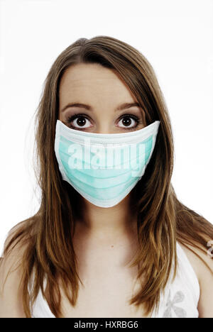 Woman with mask, pork influenza, Frau mit Mundschutz, Schweinegrippe - Stock Photo