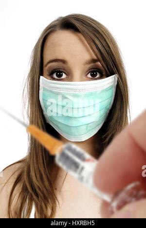 Woman with mask, vaccination against the pork influenza, Frau mit Mundschutz, Impfung gegen die Schweinegrippe - Stock Photo