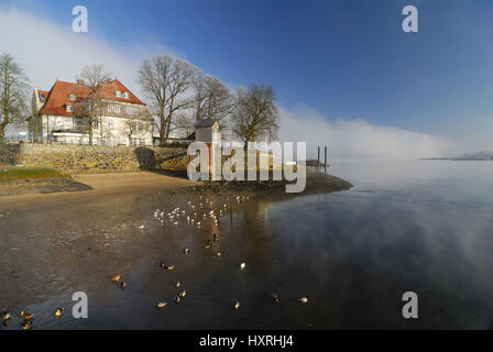 The Zollenspieker ferry boat-house and wall of fog over the Elbe in Kirchwerder, Hamburg, Germany, Europe, Das Zollenspieker - Stock Photo