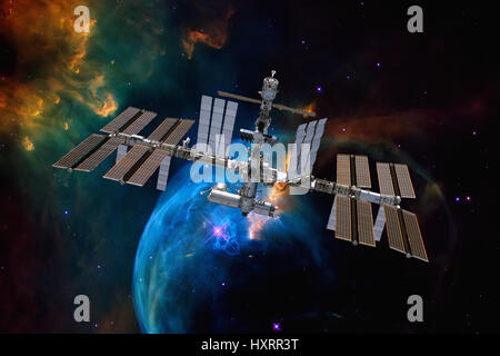 International Space Station over nebula. Elements of this image furnished by NASA. - Stock Photo