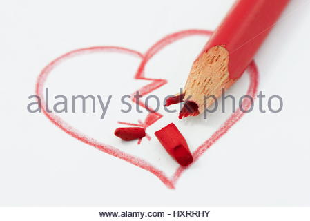 Broken heart concept strengthened by broken red pencil - Stock Photo