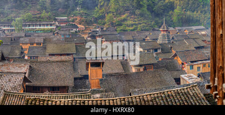 Zhaoxing Dong Village, Guizhou Province, China -  April 9, 2010:  Tile roofs farmhouses in the mountain village - Stock Photo