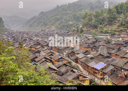 Zhaoxing Dong Village, Guizhou Province, China -  April 7, 2010:  Tile roofs of wooden houses in the mountain village - Stock Photo