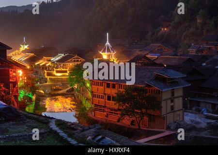 Zhaoxing Dong Village, Guizhou Province, China -  April 8, 2010: Ethnic minority village at evening illumination - Stock Photo