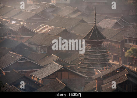 Zhaoxing Dong Village, Guizhou Province, China -  April 9, 2010: Tile roofs of wooden houses of Chinese peasants - Stock Photo