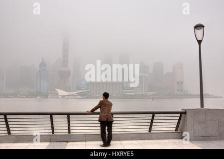 Shanghai, China - April 20, 2010: Air Pollution, high-rises shrouded in heavy smog,  air in City remained severely - Stock Photo