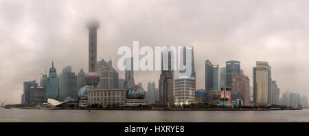 Shanghai, China - April 20, 2010: Air Pollution in City, Buildings are shrouded in smog, Pudong District evening - Stock Photo