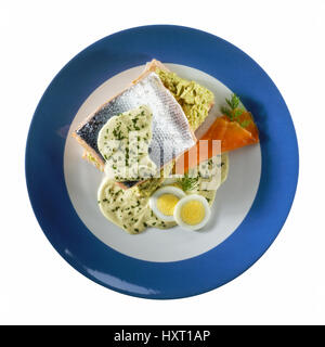 salmon fillet served with barnaise sauce, carrots and eggs. - Stock Photo
