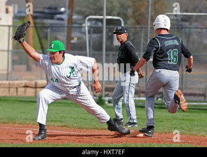 Albuquerque, NM, USA. 29th Mar, 2017. Albuquerque High's #44 Isaiah Urrutia makes the catch and the out on the runner - Stock Photo