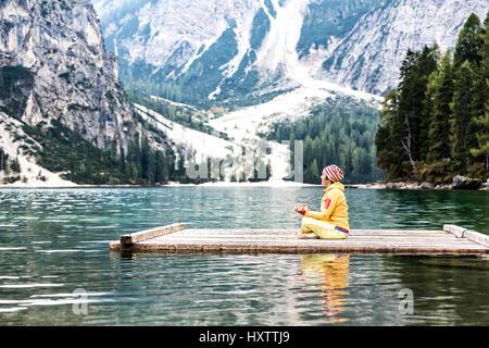 Yoga at the lake, lago di braies, Dolomites - Stock Photo