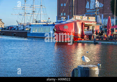 Fishing boat with sales stall in the port of the Hanseatic City of Stralsund, Mecklenburg-Pomerania, Germany. - Stock Photo