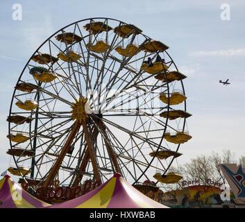 Ferris wheel with airplane on the background, horizontal image - Stock Photo