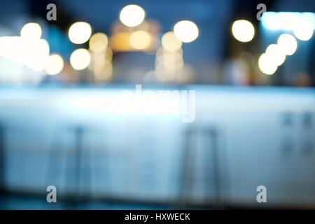 background created with blurred lights of a pub - Stock Photo