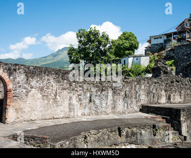 Volcano of Mont Pelee above Ruins of St. Pierre Destroyed by Volcanic Eruption 1902 on Caribbean Island of Martinique - Stock Photo