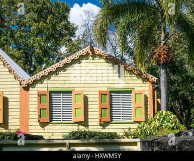 Buildings and Palm Trees at Romney Manor on Caribbean Island of St. Kitts - Stock Photo