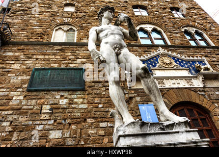 The famous statue David of Michelangelo (reproduction) in front of the entrance of the Palazzo Vecchio, now the - Stock Photo