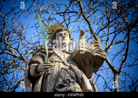 An angel in front of the abbey church St. Stephanus and St. Vitus, Abbey Castle Corvey in Hoexter, Weserbergland, - Stock Photo