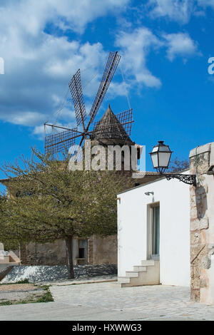 PALMA DE MALLORCA, BALEARIC ISLANDS, SPAIN - MARCH 29, 2017: Home entrance and windmill detail in Es Jonquet area - Stock Photo