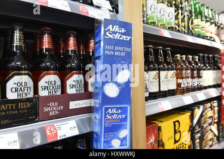 Beer and Alka Selzter on Sale in Aldi Supermarket Christmas excess - Stock Photo