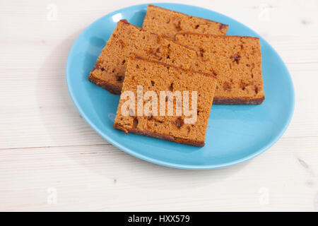 Traditional Dutch cake Ontbijtkoek on wooden background - Stock Photo