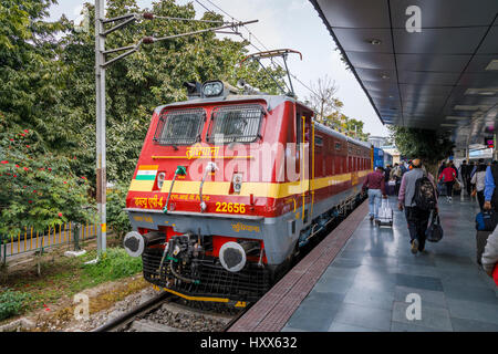 Red train engine at the platform in Kalka Station, Kalka, Haryana, northern India, terminus of the Delhi to Kalka - Stock Photo