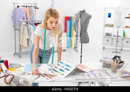 young blonde fashion designer woman checking color palette samples - Stock Photo