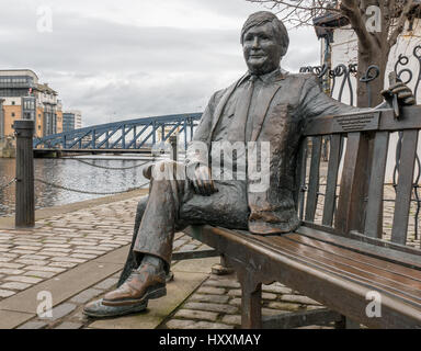 Close up of statue of Sandy Irvine Robertson, OBE, by Lucy Poett, seated on a bench, The Shore, Water of Leith, - Stock Photo