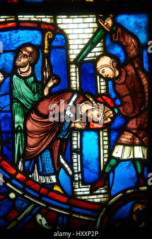 Stained glass windows depicting scenes from the life of Saint Nicaise, 13th century from Cathedral of Soissons. - Stock Photo