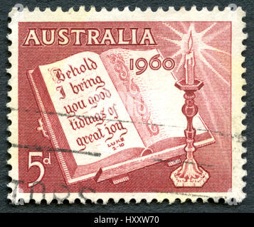 AUSTRALIA - CIRCA 1960: A used postage stamp from Australia, depicting a religious message from Luke 2:10 to celebrate - Stock Photo