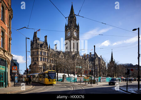 Metrolink second crossing passes Manchester City Council Town Hall in Albert Square  Manchester, England, UK.   - Stock Photo