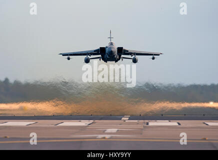 Panama Gr4 Tornado Twin jet engined Aircraft at low level takeoff from home base, RAF Lossiemouth Air Station, Morayshire - Stock Photo