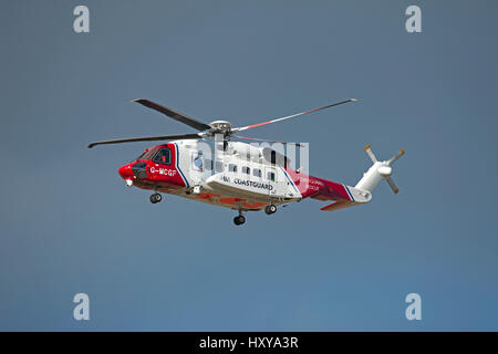 Inverness based Sikorsky S-92A Coastguard SAR helicopter departing from its home base on a mission. - Stock Photo