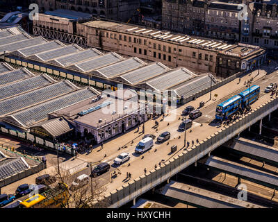 Edinburgh Waverley Station exterior showing Waverley Bridge at west of station and extensive glass roof covering - Stock Photo