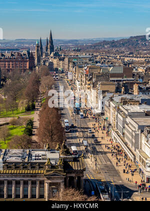 View down Princes Street, Edinburgh with spires of St John's Episcopal Church, Charlotte Chapel, and St Mary's Cathedral - Stock Photo