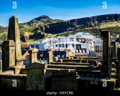 Scottish Parliament building, Holyrood, Edinburgh, Scotland. Viewed through gravestones at New Calton Burial Ground. - Stock Photo