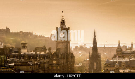 View across Edinburgh from Calton Hill with the Dugald Stewart Monument and Balmoral Hotel Clocktower. - Stock Photo