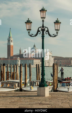 Spring afternoon in sestiere of San Marco, Venice, Italy. San Giorgio Maggiore church in the distance. - Stock Photo