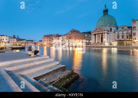 Night falls on Grand Canal in Venice, Italy. Iconic dome of San Simeone Piccolo. - Stock Photo