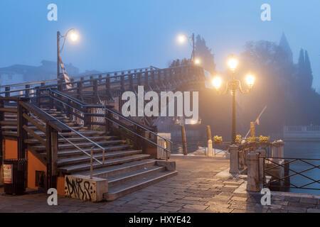 Foggy dawn at Ponte dell'Accademia in Venice. - Stock Photo