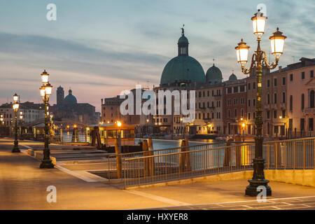 Dawn in sestiere of  Cannareggio, Venice, Italy. San Simeone Piccolo church dome in the distance. - Stock Photo