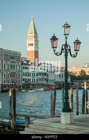 Spring afternoon on Grand Canal in Venice, Italy. Campanile in the distance. - Stock Photo