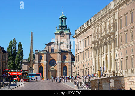 Gamla Stan (Old Town) clock tower of Great Church (Storkyrkan) with The Royal Palace at right in Stockholm, Sweden. - Stock Photo