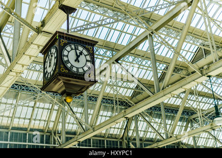 Large Clock in Glasgow's Central Station Train Station - Stock Photo