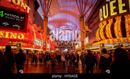 Tourists cross the road at Freemont Street on the Las Vegas Strip at night - Stock Photo