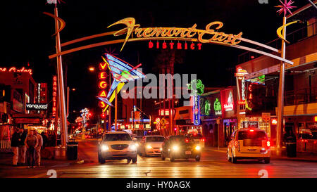 Neon lights and traffic at Freemont Street on the Las Vegas Strip at night - Stock Photo