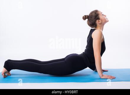 Beautiful sporty fit yogini woman practices yoga asana adhomukha svanasana - downward facing dog pose isolated on - Stock Photo