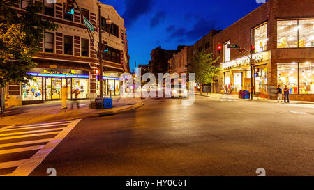 Pedestrians and traffic on a busy city street in downtown Asheville, North Carolina - Stock Photo