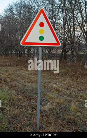 Road sign warning about traffic light regulation of the European standard - Stock Photo